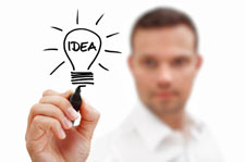 Man holding light bulb marked 'IDEA'.