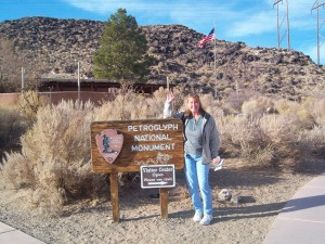 Standing in front of the sign for Petroglyph National Park.